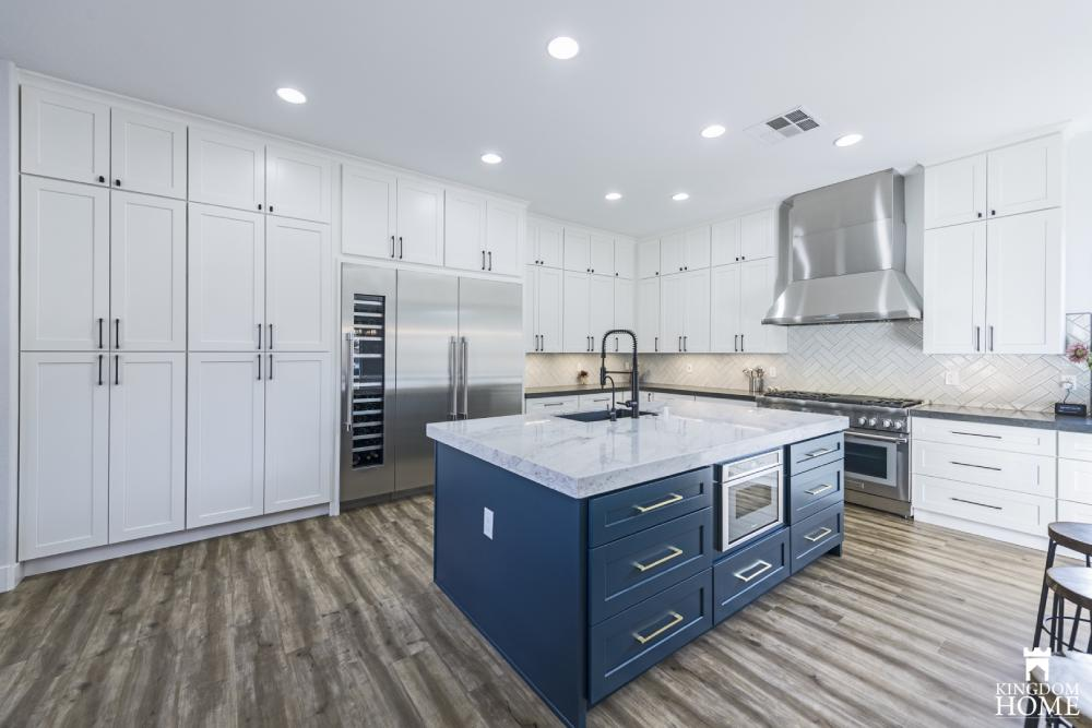 blue island in white kitchen in upgraded house