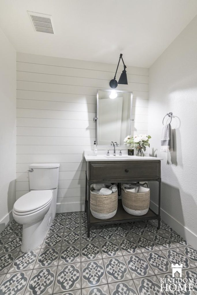 renovated home with shiplap bathroom