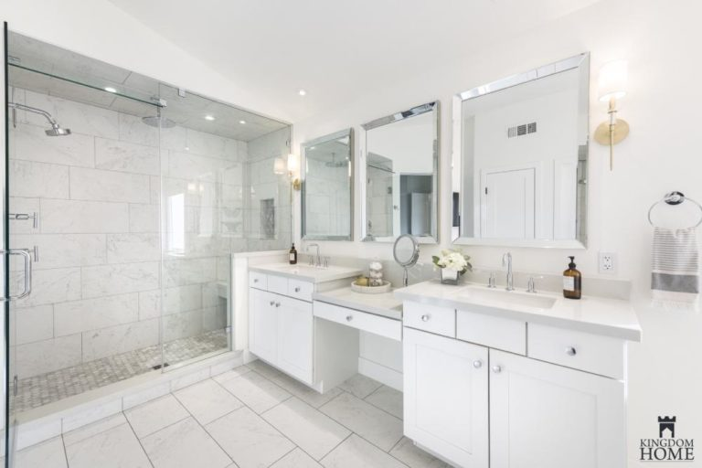 all white master bathroom in renovated home