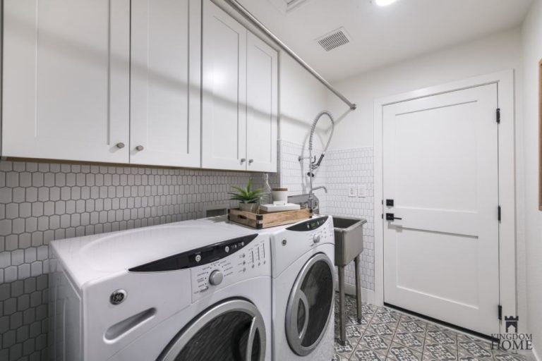 renovated home with tiled laundry room