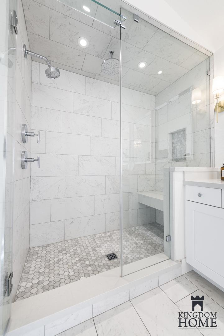 tiled master shower in renovated home